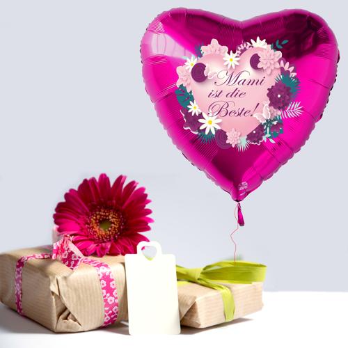 Tischdeko Muttertag. Geschenke, eine Blume und ein Luftballon in Pink mit der Mitteilung: Mami ist die Beste!